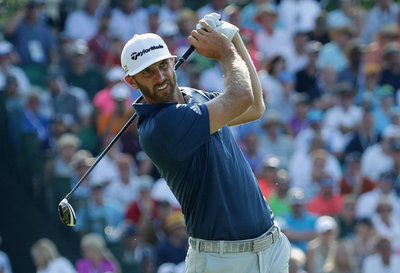 DUSTIN JOHNSON BREAKS SCORING RECORD TO CLAIM HIS FIRST GREEN JACKET